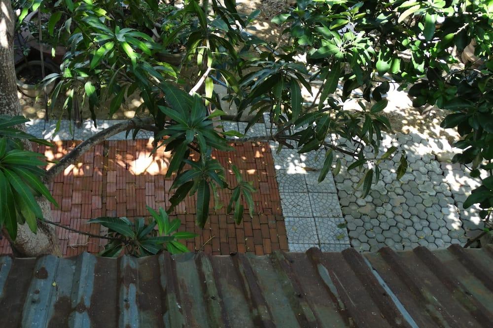 Camera tripla, vista giardino - Balcone