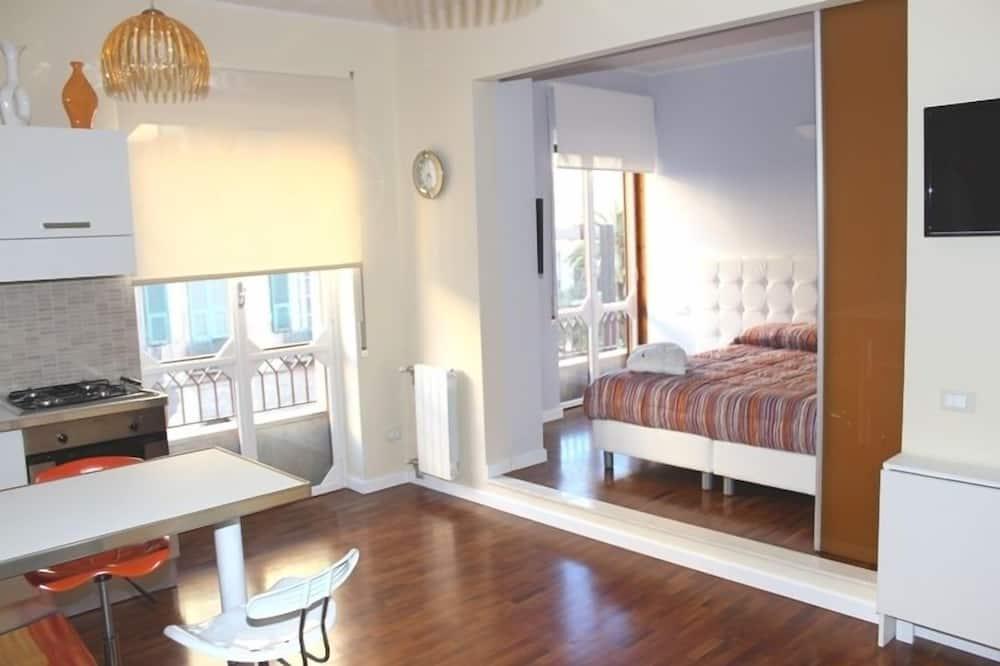 Suite estudio Premium, 1 cama doble con sofá cama, cocina básica - Sala de estar