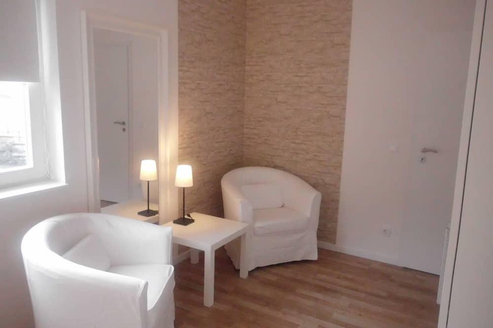 Designový pokoj s dvojlůžkem, vhodný pro alergiky - Obývací prostor