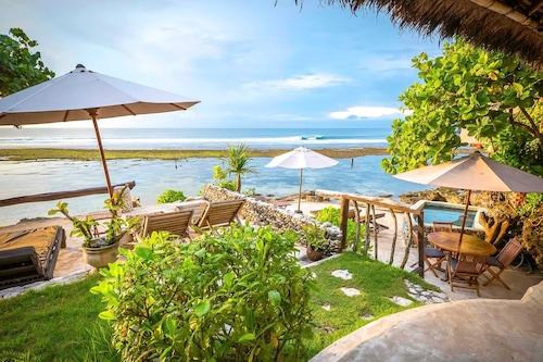 石與珊瑚礁海灘酒店/