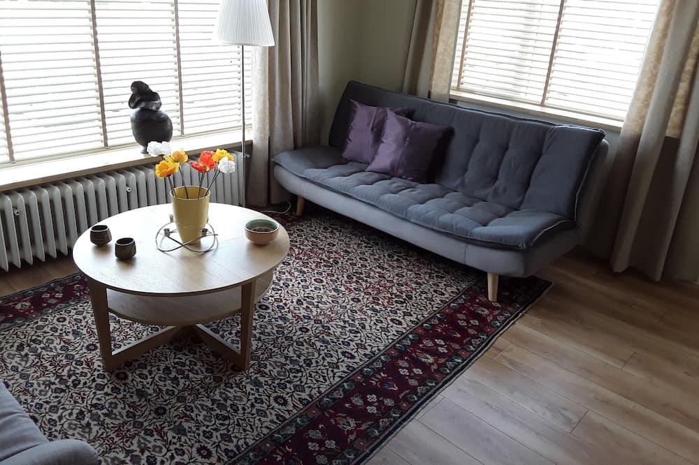อพาร์ทเมนท์สำหรับครอบครัว, 1 ห้องนอน - พื้นที่นั่งเล่น
