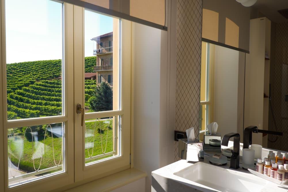 Kambarys su patogumais (Hotel Vigna Magica) - Vonios kambarys