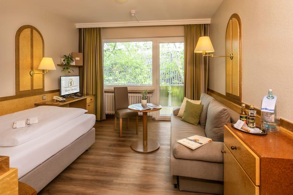 Одноместный номер «Комфорт», 1 широкая односпальная кровать, балкон - Зона гостиной