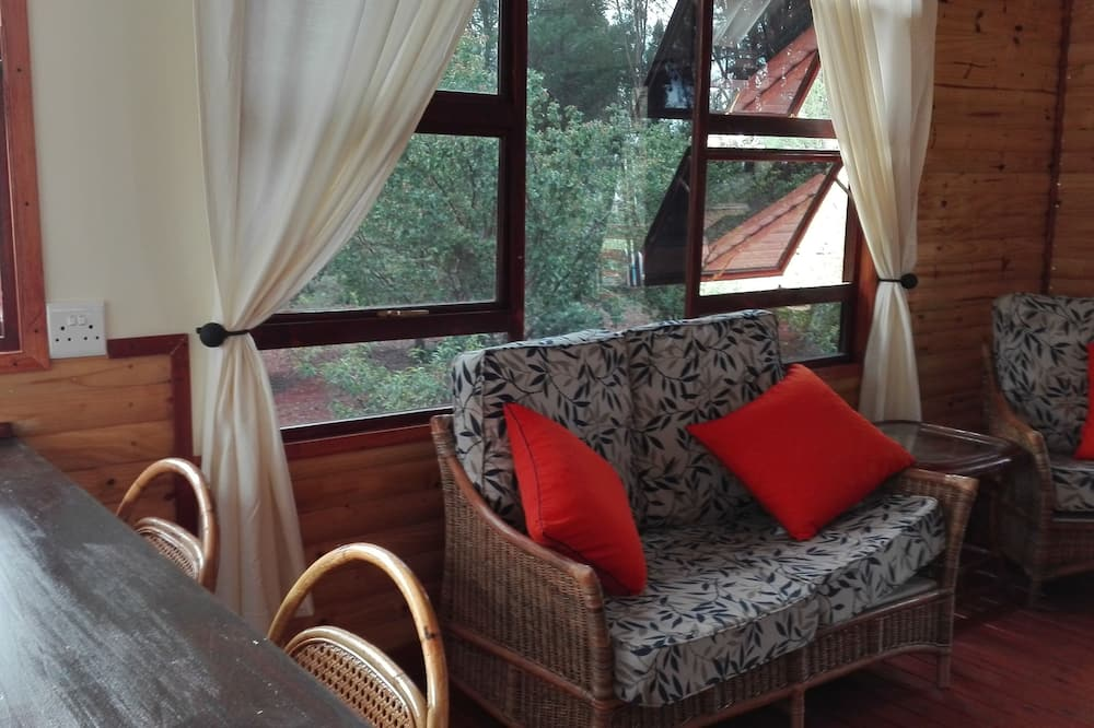 ชาเลท์โรแมนติก, 1 ห้องนอน, ปลอดบุหรี่, วิวภูเขา - พื้นที่นั่งเล่น