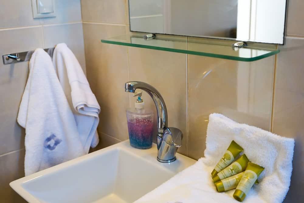 Habitación Deluxe doble, vistas al mar - Lavamanos en el baño