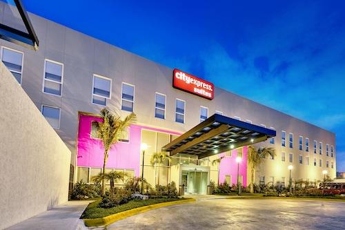卡门海滩城市套房酒店/