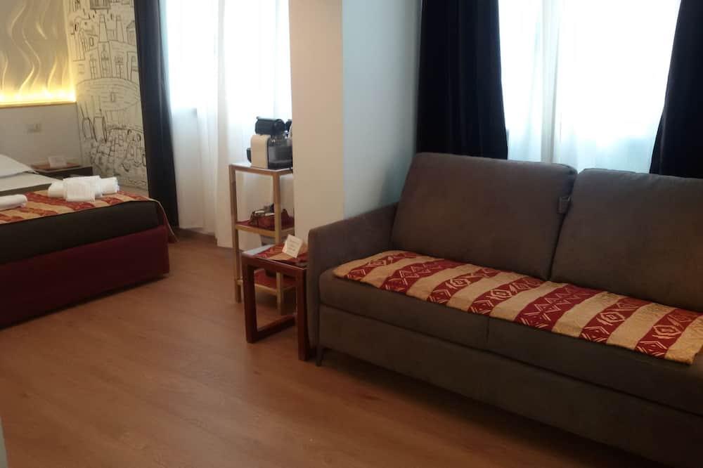 Izba typu Deluxe, 1 veľké dvojlôžko s rozkladacou sedačkou, bezbariérová izba, súkromná kúpeľňa - Obývacie priestory