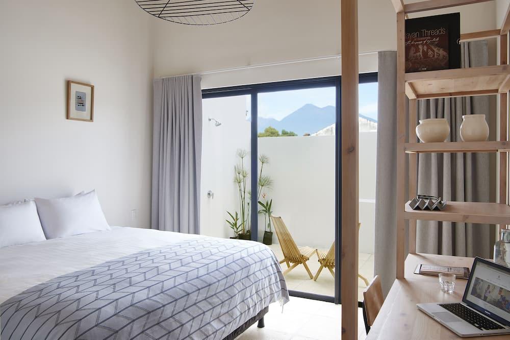 חדר דה-לוקס זוגי, פטיו, נוף לגן - תמונה