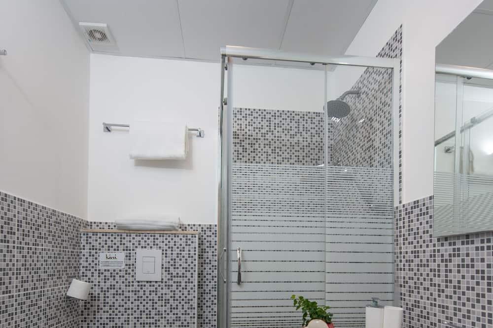 szoba kétszemélyes ággyal egy fő részére - Fürdőszoba