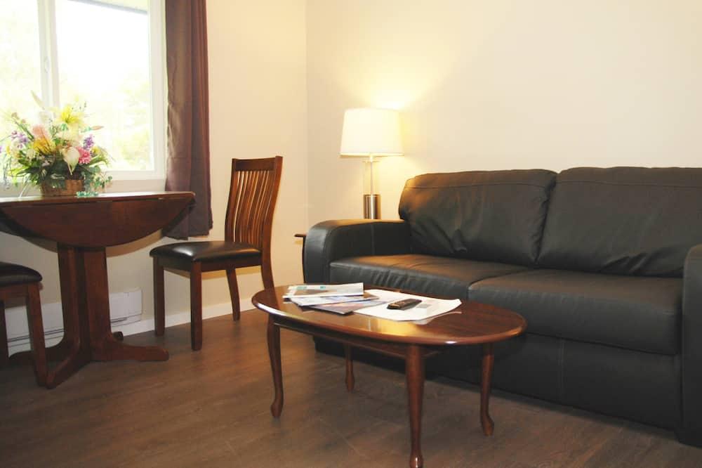 Deluxe Suite, 1 Bedroom - Ruang Tamu