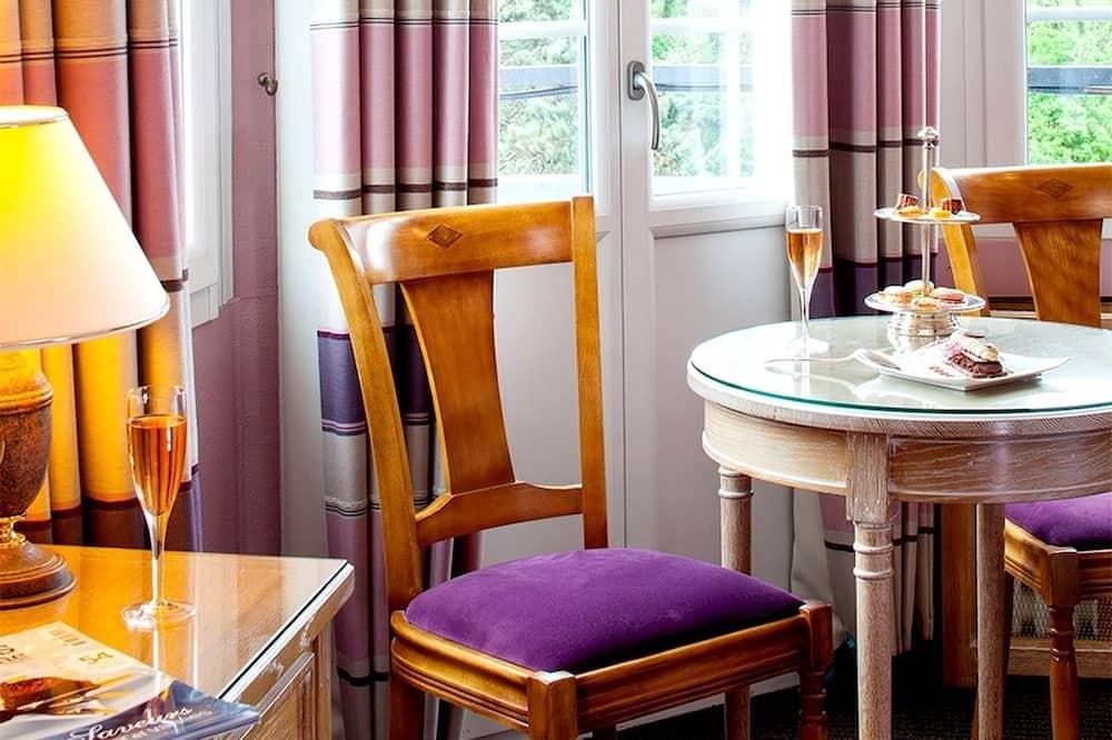 Třílůžkový pokoj typu Comfort - Obývací prostor
