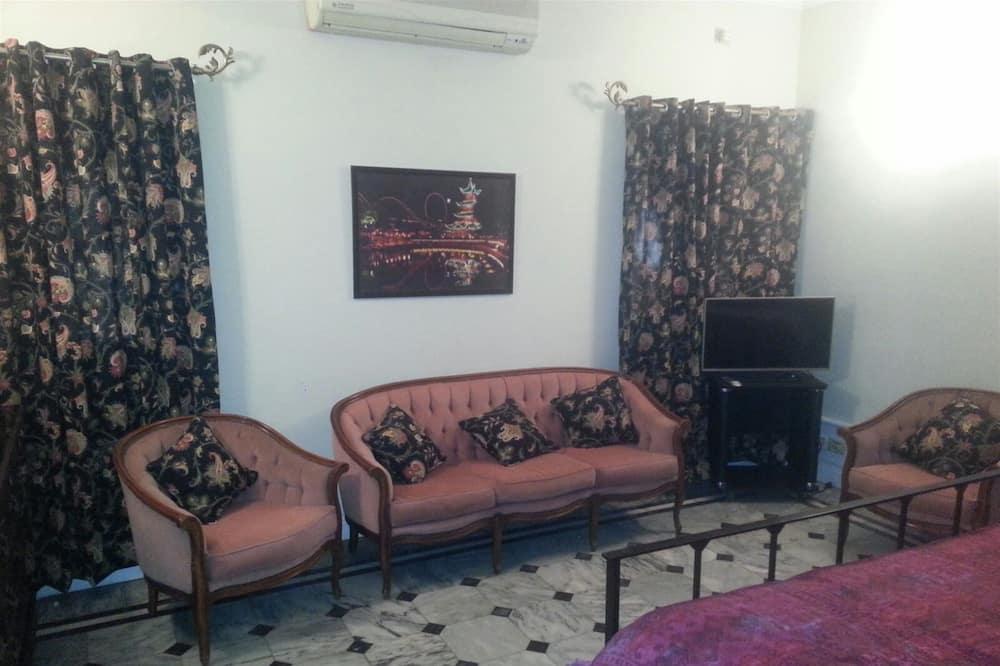 Deluxe King Room - غرفة معيشة