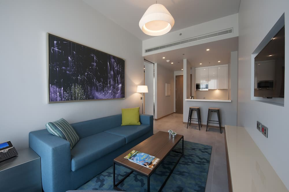 Deluxe One-Bedroom Apartment With Balcony - Living Area