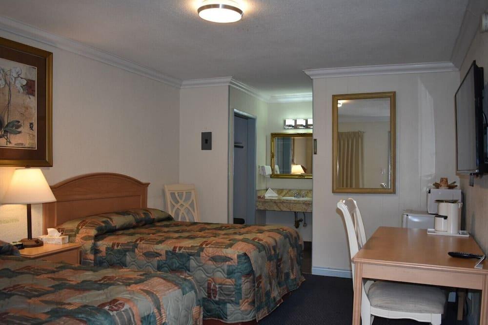 Standarta divvietīgs numurs, 2 divguļamās gultas - Vannasistaba