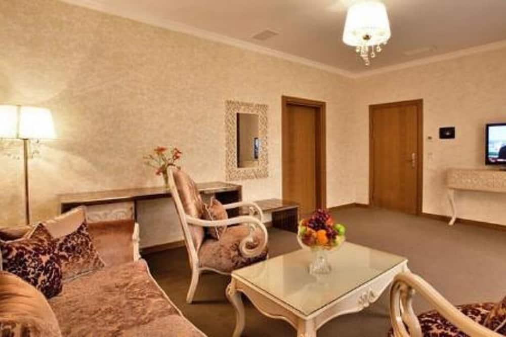 Розкішний номер-люкс, 1 ліжко «кінг-сайз», для курців, з видом на місто - Обіди в номері