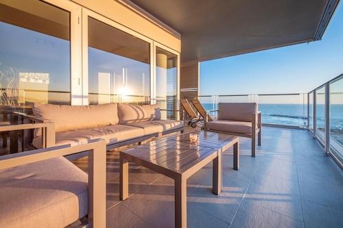 你的時尚海灘公寓/