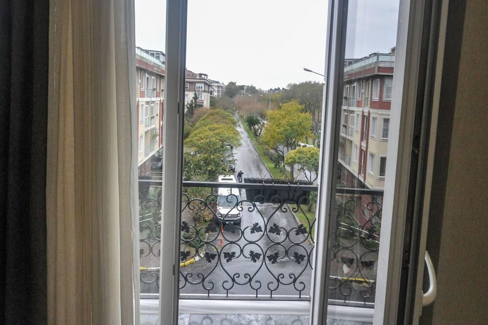 Tweepersoonskamer - Uitzicht vanaf balkon
