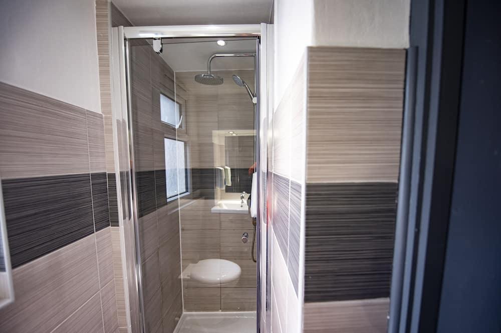 Standartinio tipo keturvietis kambarys, bendras vonios kambarys - Vonios kambarys