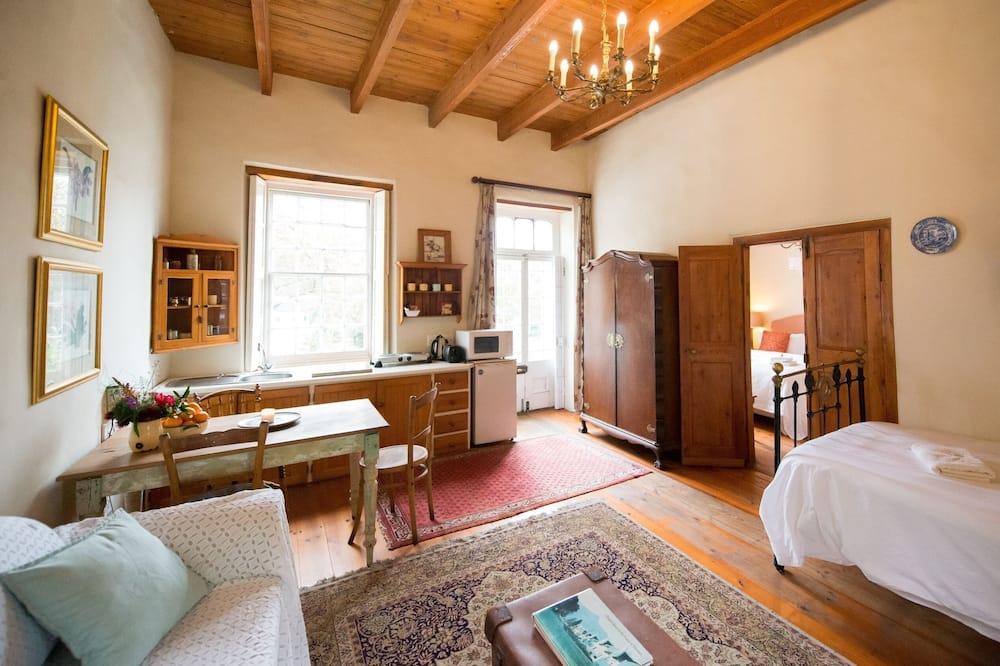 Suite superior, con vista al jardín - Sala de estar