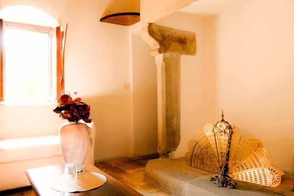Chambre Deluxe Double ou avec lits jumeaux, cheminée - Coin séjour