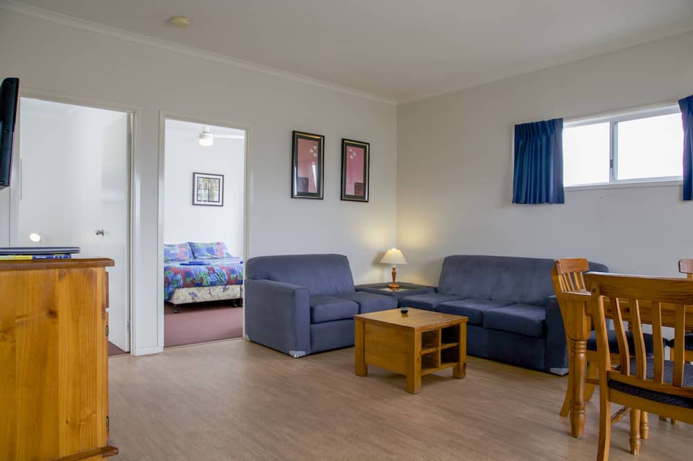 Two Bedroom Cabin (1 King and 2 Single Beds) - Living Room
