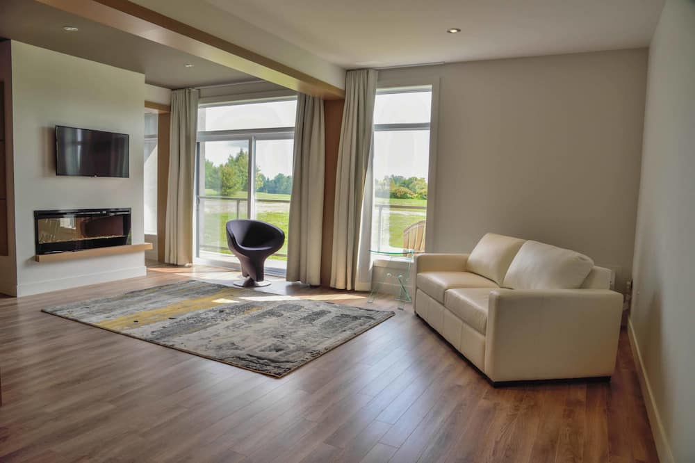 Suite ejecutiva, 1 cama de matrimonio grande con sofá cama, vistas al campo de golf - Zona de estar