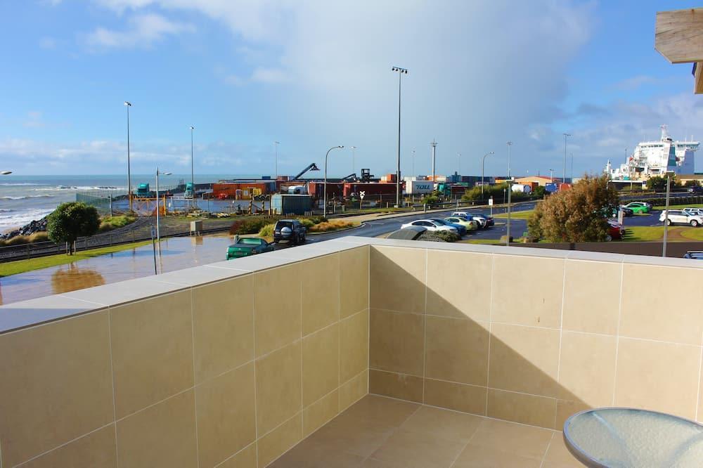 Deluxe-suite - udsigt til havn - ved havet - Altan