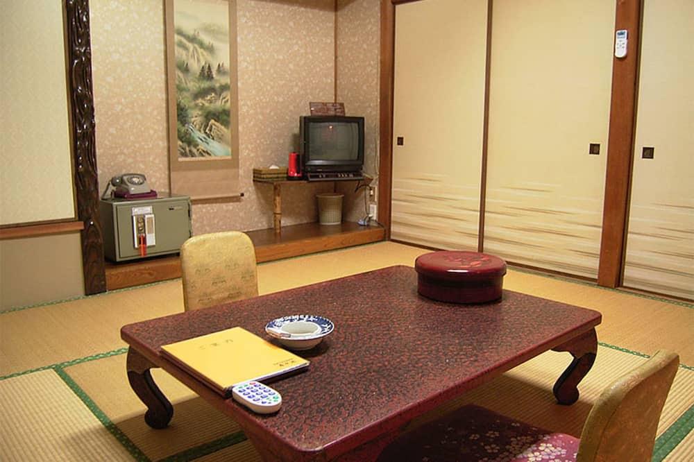 Tradicinio tipo kambarys - Vakarienės kambaryje