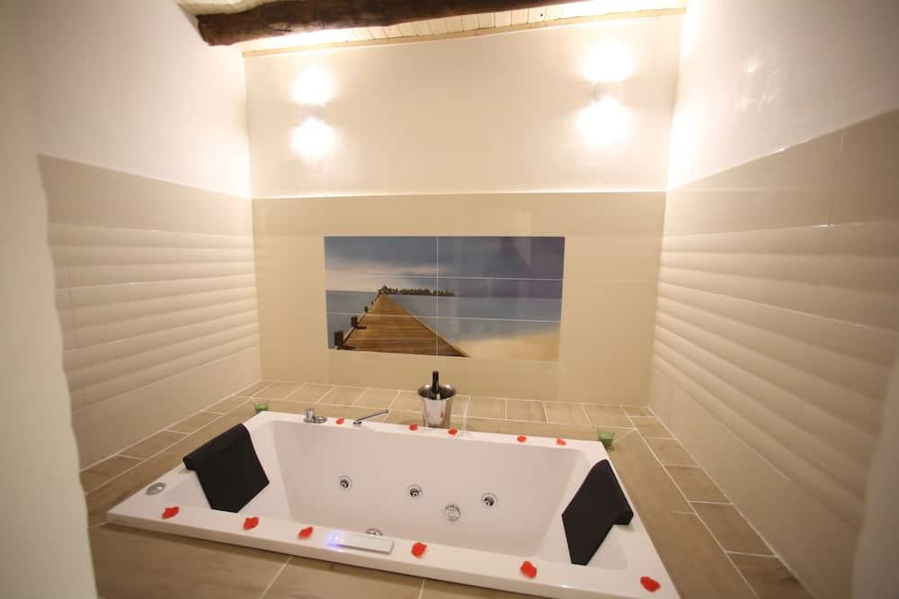 Exclusive tuba, 1 lai voodi, asukoht siseõues / siseõuepoolne (Zona vasca idromassaggio) - Massaaživann siseruumides