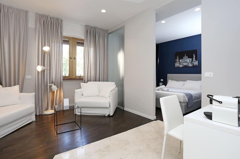 Suite Deluxe, plusieurs lits, réfrigérateur, vue ville - Chambre