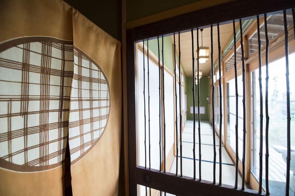 Deluxe-Maisonette, 6Schlafzimmer, Nichtraucher, Gartenblick - Wohnbereich