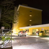 Hotel Front – Evening/Night