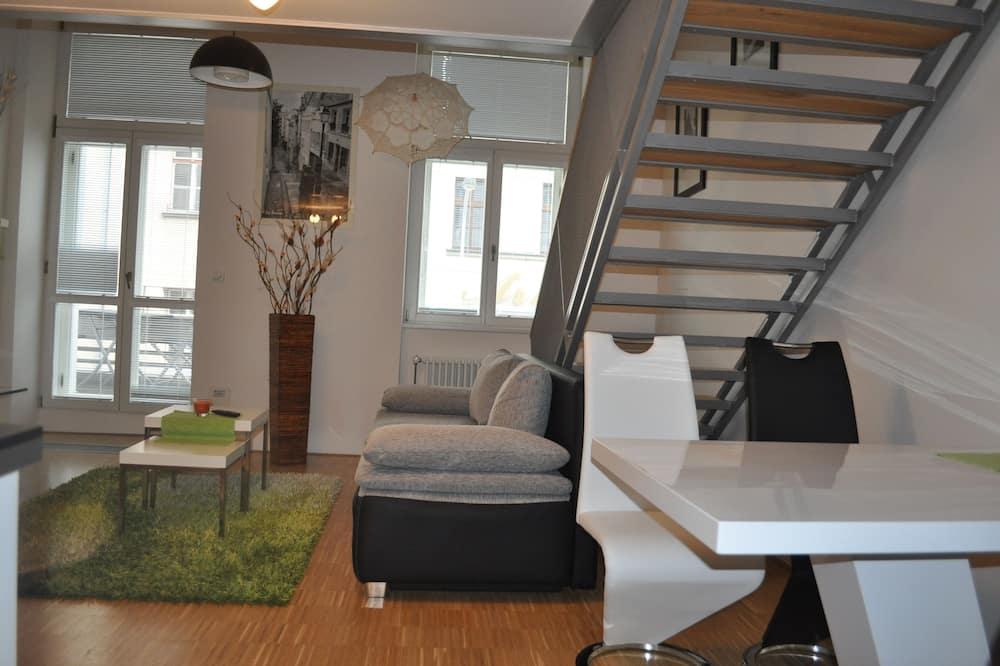 Dvoupodlažní apartmá typu Deluxe, balkon - Obývací prostor