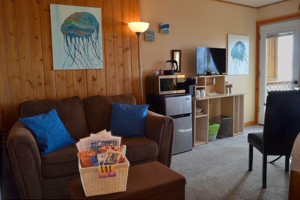 סוויטת סטודיו פנורמית, מיטת קינג וספה נפתחת, נוף לאוקינוס, פונה לים - אזור מגורים