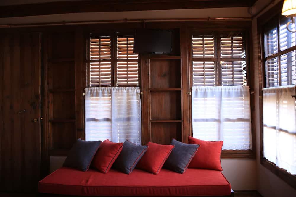 Eenvoudige driepersoonskamer - Woonruimte