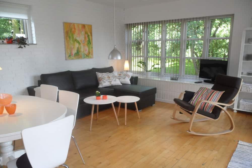 Lejlighed - 1 soveværelse - terrasse - udsigt til have - Stue