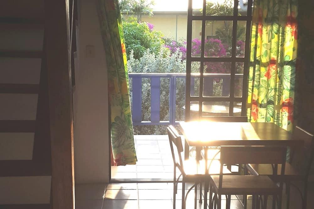 Signature-Loft, Kochnische, Gartenblick (Apartment, First Floor) - Essbereich im Zimmer