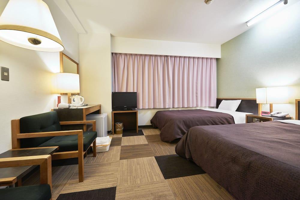 غرفة عادية لاثنين - لغير المدخنين (2 Semi-Double Beds) - غرفة نزلاء