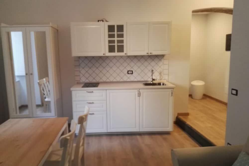 Habitación cuádruple familiar, 1 habitación, vista a la ciudad - Sala de estar