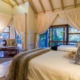 Suite estudio exclusiva, Varias camas, bañera de hidromasaje, vista al jardín - Sala de estar