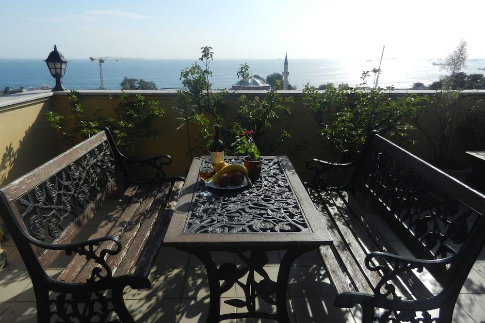 Luksusa numurs, viena guļamistaba, virtuvīte, skats uz jūru - Terase/iekšējais pagalms