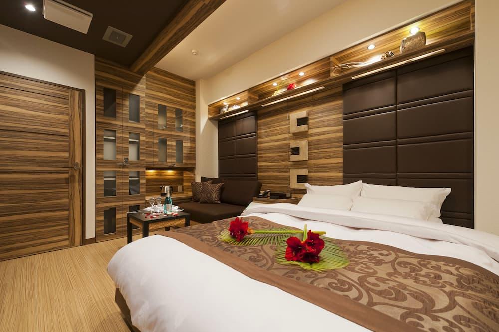 Chambre - Salle de séjour