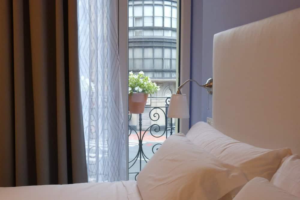 Pagerinto tipo kambarys (1 dvigulė / 2 viengulės lovos) - Svečių kambarys