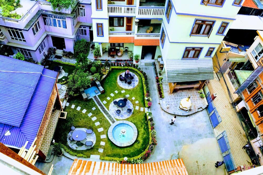 スーペリア ダブルまたはツインルーム 2 ベッドルーム 禁煙 ガーデンビュー - 庭園