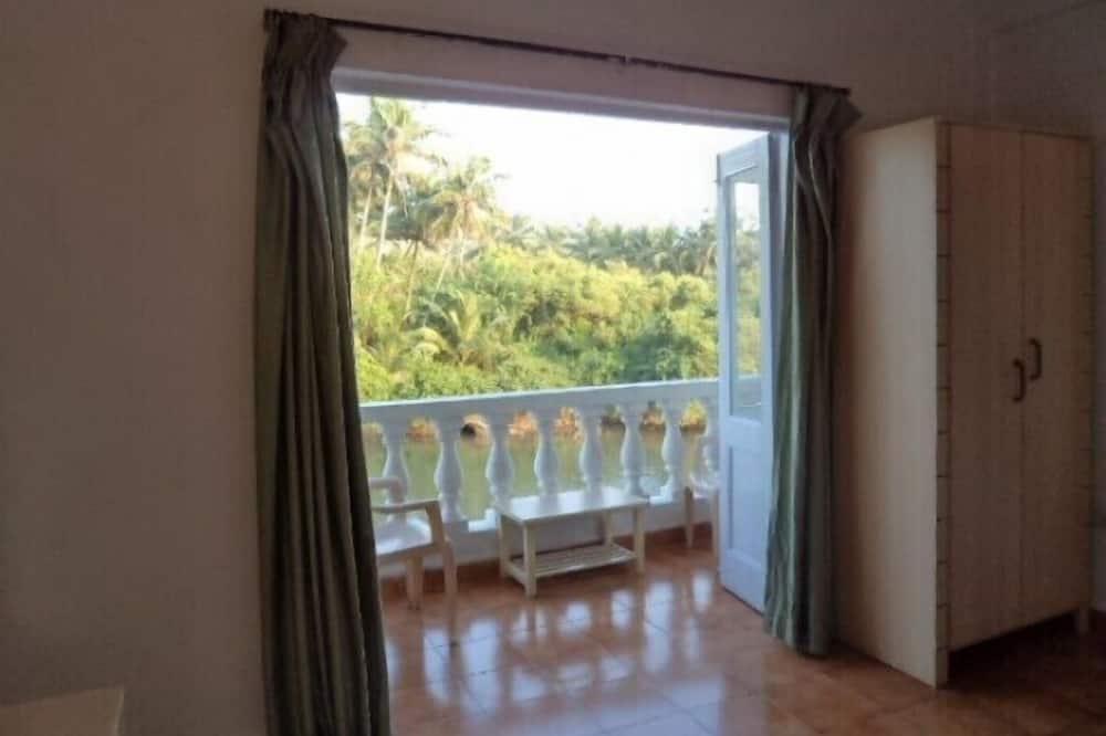 Chambre Deluxe, vue fleuve - Balcon