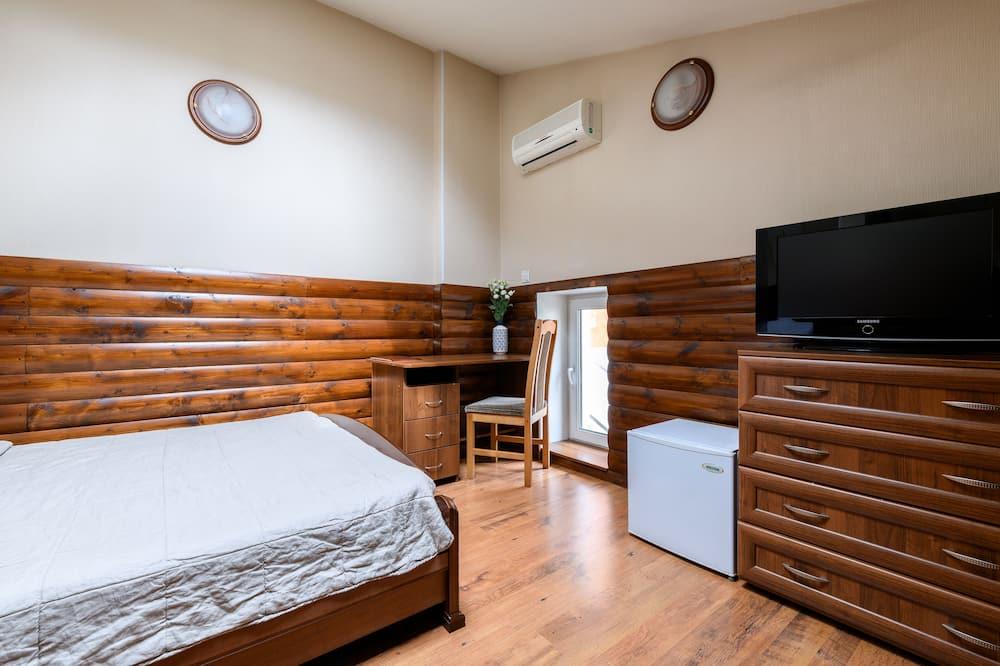 Családi négágyas szoba, 1 queen (nagyméretű) franciaágy és egy kihúzható kanapé - Nappali rész