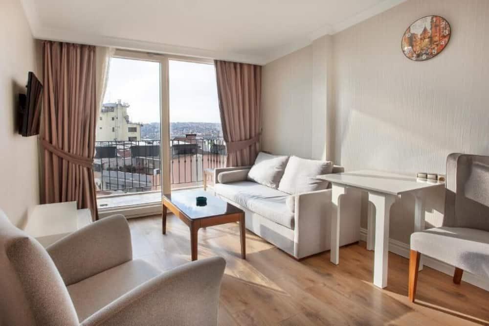 Suite Deluxe, 1 camera da letto, lanai, vista mare parziale - Area soggiorno