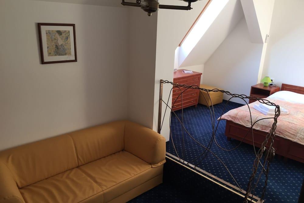 Perhehuoneisto - Olohuone
