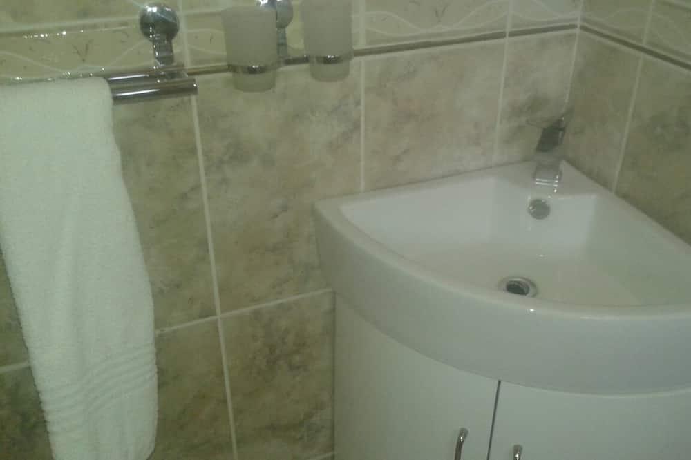 ห้องเอ็กเซกคิวทีฟ, วิวสวน - อ่างล้างมือ