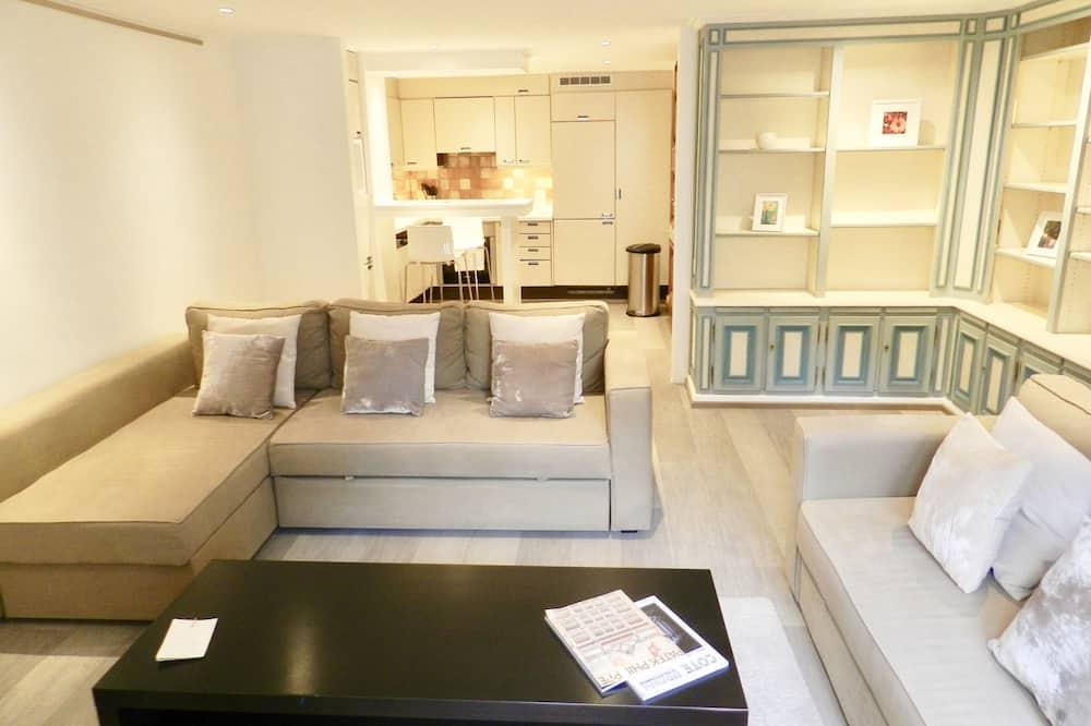 شقة ديلوكس - غرفة نوم واحدة - منظر للمدينة - غرفة معيشة